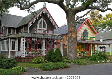 Two colorful gingerbread cottages on Martha's Vineyard. - stock photo
