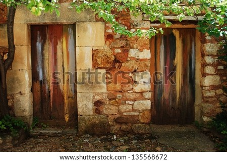 Two colorful painted doors in ocher historical village of Roussillon, Provence, France
