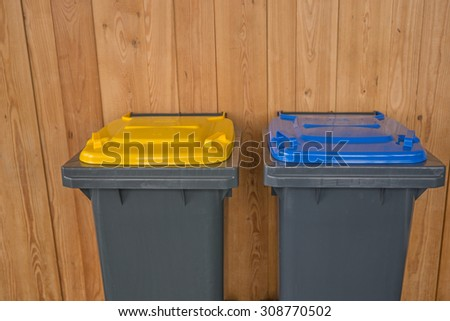Two Colorful Recycle Bins - stock photo