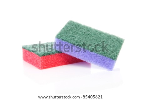 Two colorful sponge scourer over white background