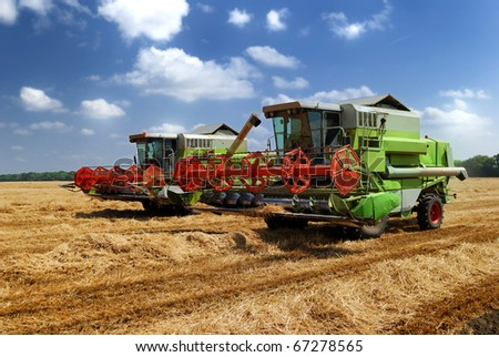 two combine harvesters working on the field. Krasnodar, Russia - stock photo