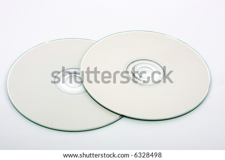 Two compact disks over a white background