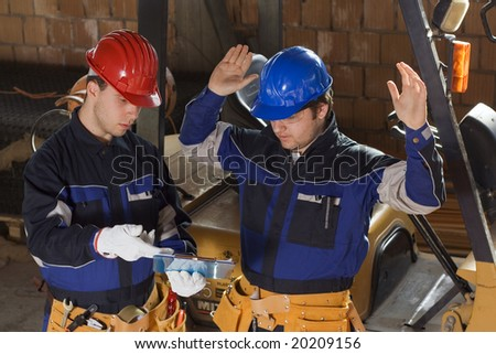 Two construction worker reading project - stock photo