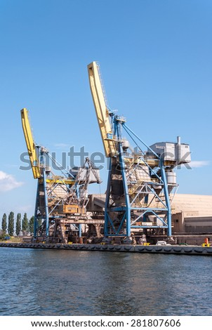 Two container cranes in Gdansk harbor in Poland