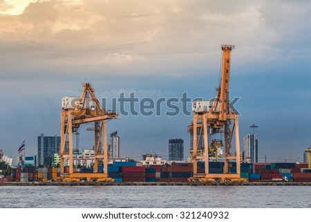 Two container cranes in Hamburg at night - stock photo