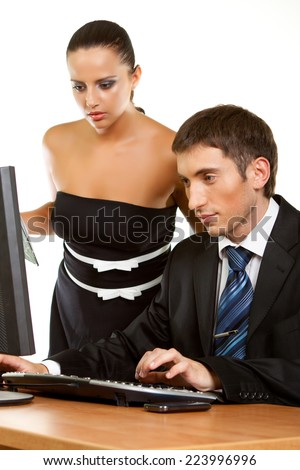 Two contemporary businesspeople discussing while working at the computer Isolated on white background - stock photo