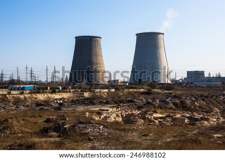 Two cooling towers of the cogeneration plant near Kyiv, Ukraine. - stock photo