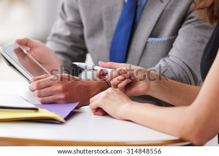 Two corporate business colleagues at work, close up of hands - stock photo