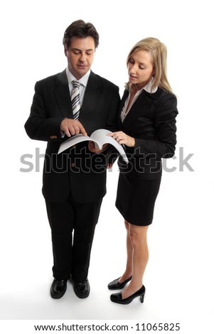 Two corporate executives reading a report, contract, tender or other document. - stock photo