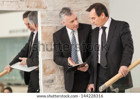 Two corporate professionals having discussion - stock photo