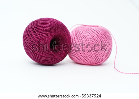 two cotton yarn balls of pink and purple colors isolated on white background - stock photo