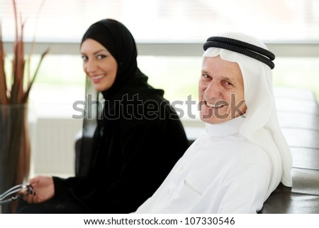 Two couple Muslim in office - stock photo