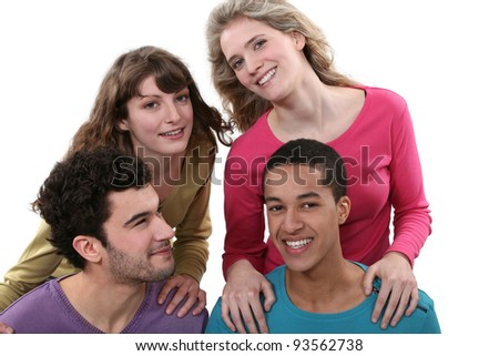 Two couples doing a piggy back ride race. - stock photo