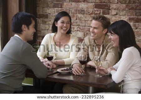 Two Couples Enjoying a Glass of Wine