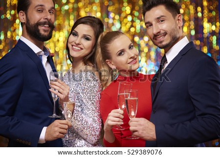 Two couples on glitter background