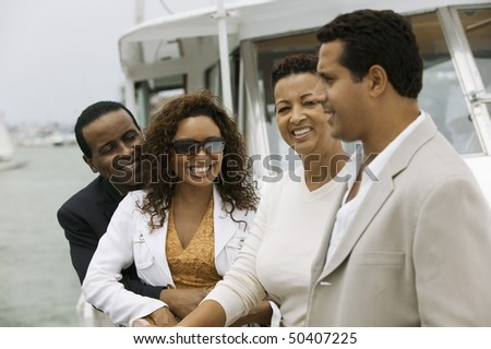 Two couples relaxing on yacht