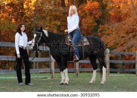 Two Cowgirls with Horse - stock photo