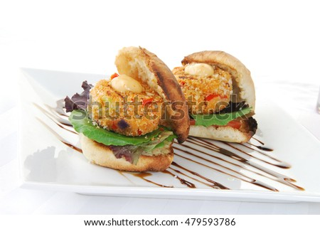 Two crabcake sandwiches on toasted buns close up