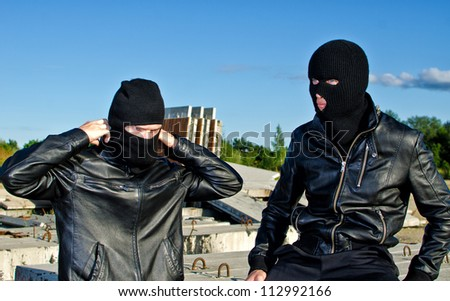 Two criminals getting ready for robbery - stock photo