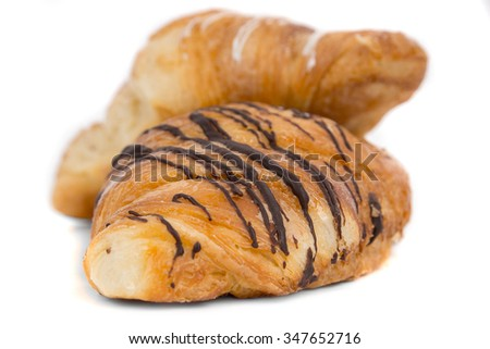 Two croissant with different glaze.Isolated on white background