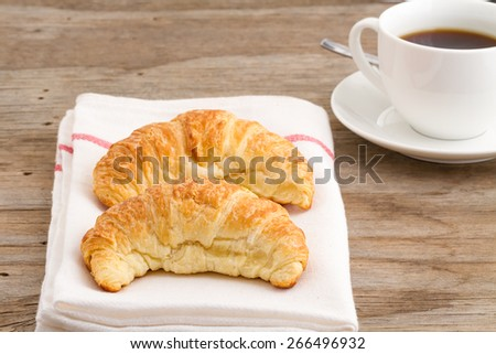 two croissants for breakfast  - stock photo