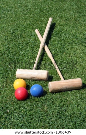 Two croquet mallets and three balls - stock photo