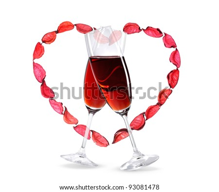 Two crossed wineglasses with red wine and a heart shape made from rose petals. Isolated on white background. Love, Valentine's Day concept. - stock photo