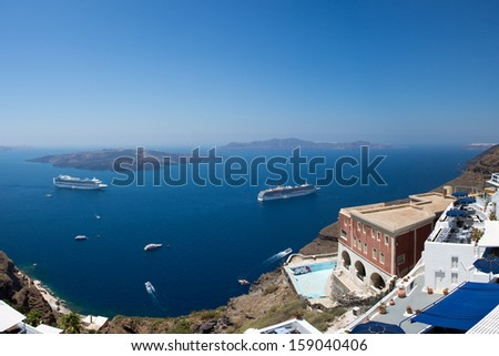 Two cruise ships and other boats in the bay of Santorini in Greece, June, 25, 2013.
