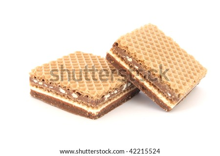 Two crunchy filled wafers with cacao cream and nuts - stock photo