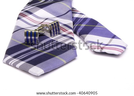 Two cufflinks on a tie. - stock photo