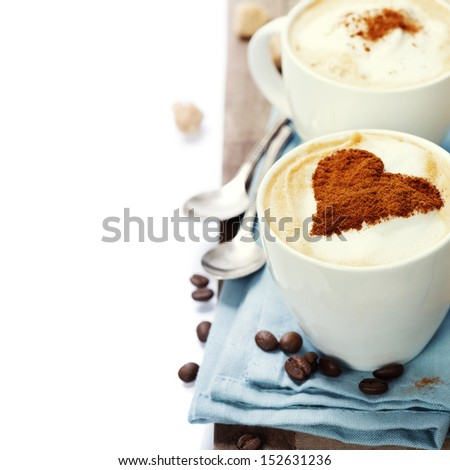two cups cappuccino over white - stock photo