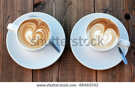 two cups of coffee cappuccino - stock photo