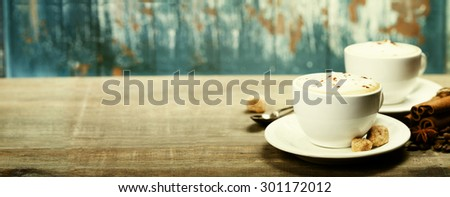 Two cups of coffee on old wooden table - stock photo