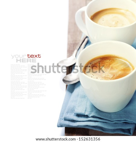 two cups of coffee with blue napkin (with sample text) - stock photo