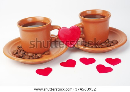 Two cups of coffee with heart shape padlock.