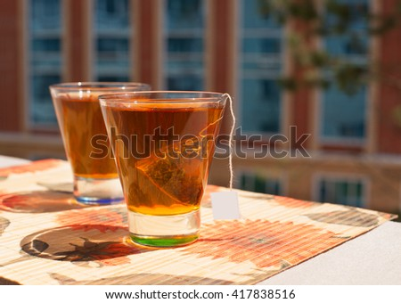 Two cups of tea for morning tea on the balcony (tea bag)