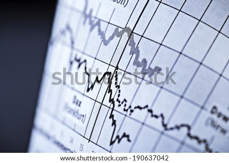 Two curves show the course of share prices on the stock exchange. - stock photo