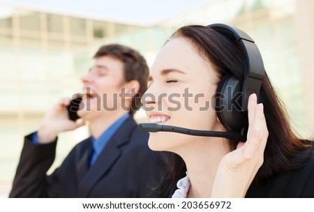 Two  customer support operators with smiling