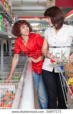 Two customers in supermarket - stock photo