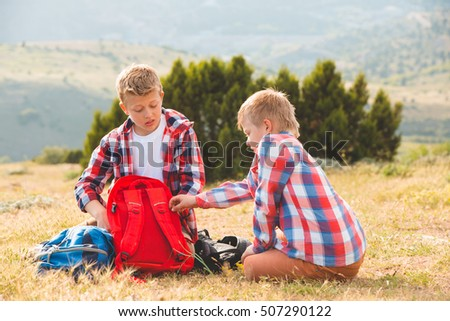 two cute boy at the mountain. family concept