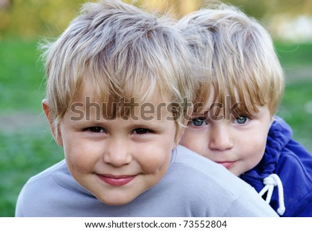 Two cute brothers in casual clothes - stock photo