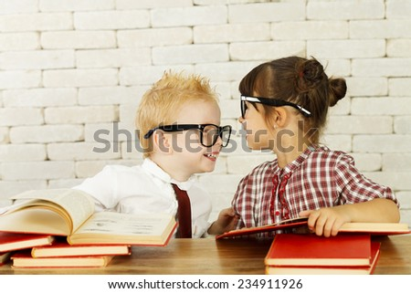 Two cute children nerds are having fun and studying  - stock photo
