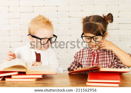 Two cute children nerds are perplexed and thinking. - stock photo