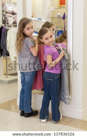 Two Cute Clothing Store Two cute girls near a mirror