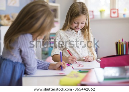 Two cute girls playing together - stock photo