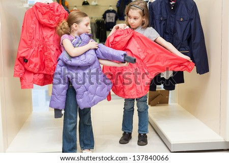 2 Cute Clothing Store Girls Two cute girls try on clothes