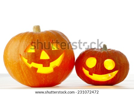 Two cute Halloween pumpkins isolated on white background - stock photo
