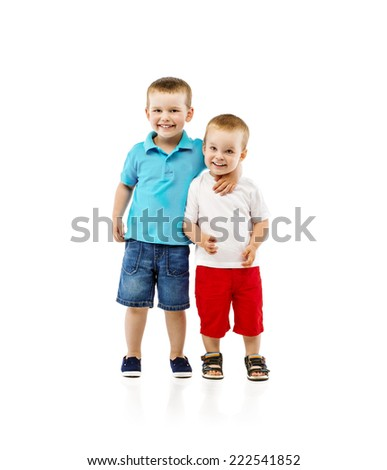 Two cute little boys hugging, isolated on white background - stock photo