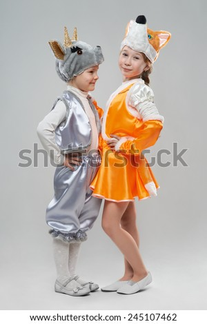 two cute little girl dressed as goats and cows - stock photo