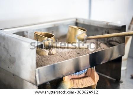 Two cute pots to prepare Turkish coffee, Cyprus - stock photo